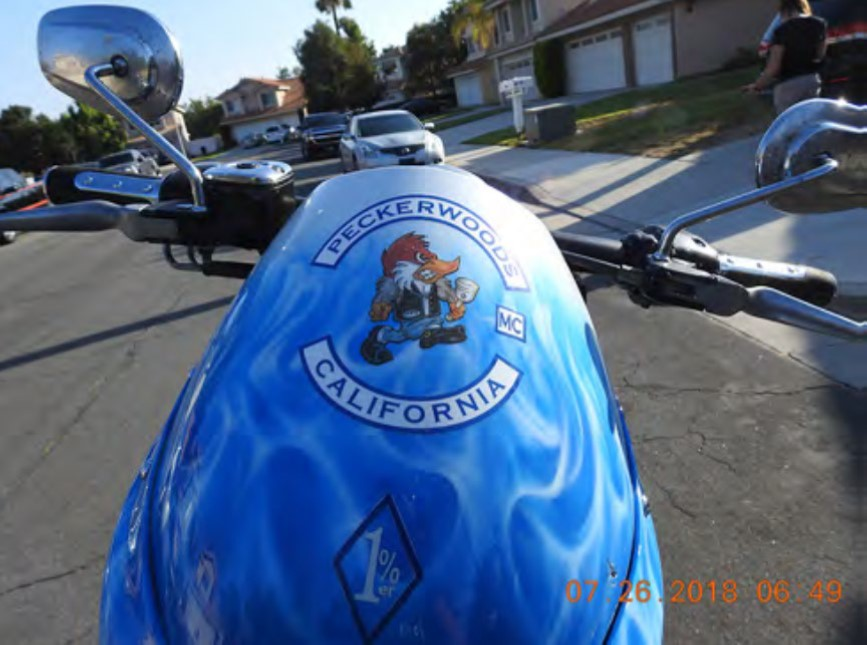 """Moncrief's motorcycle with a """"1%"""" diamond is visible at the bottom"""