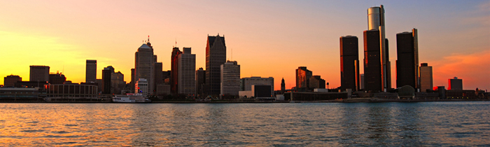 Image of the sun setting over Detroit, Michigan from the river