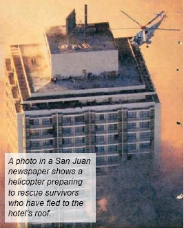 A photo in a San Juan newspaper shows a helicopter preparing to rescue survivors who have fled to the hotel roof.