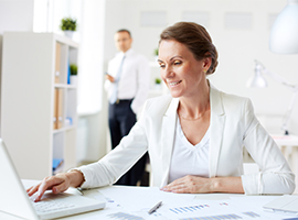 Image of a business woman at her desk