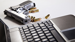 Image of a gun with a laptop