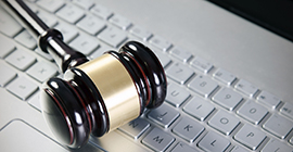 Image of a gavel on a keyboard