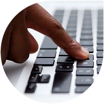 Image of a finger using a computer keyboard