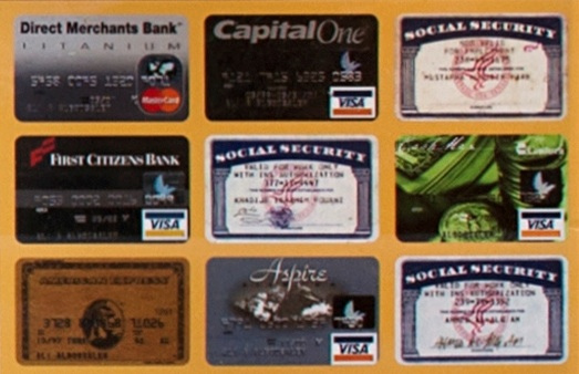 Image of credit cards and counterfeit social secuirty cards used by the defendants to make purchases and conceal their identities.
