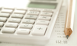 Image of a calculator and pencil