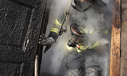 Image of a certified fire investgator after a burn