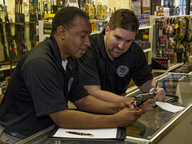 ATF Industry Operations Investigators, perform a compliance inspection at a gun store.