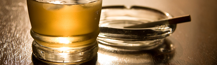 Image of an alcoholic beverage and a cigarette