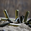 Image of bullets in the sand