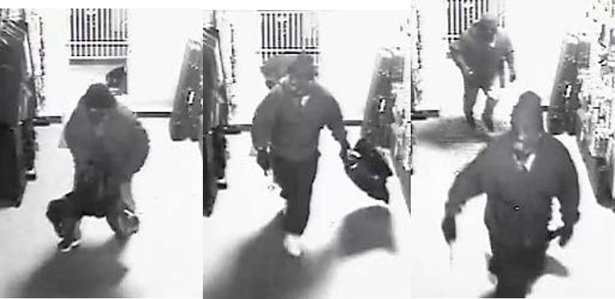 Image of two 5 foot, 7-8 inch, medium build suspects wearing a dark hoodie and gloves.