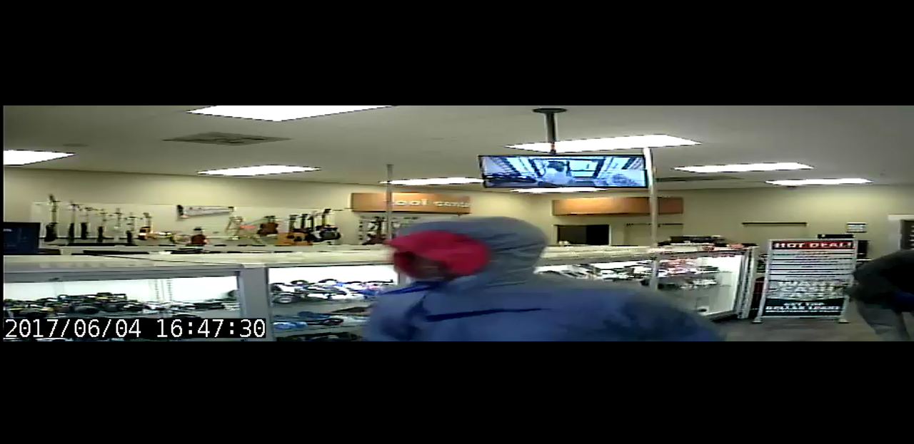 Security footage of suspect 4 during the EZ Pawn robbery.