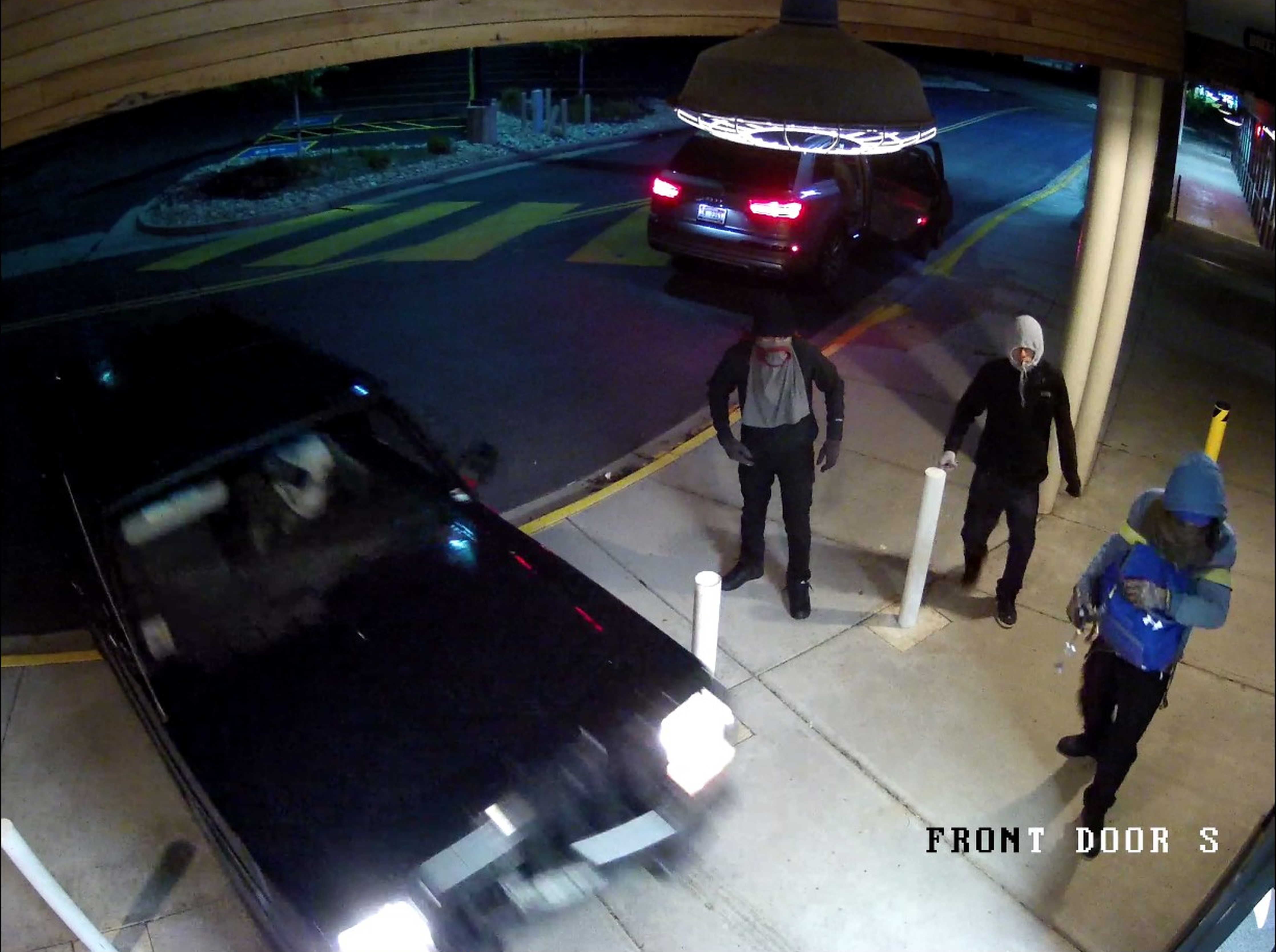 Image of all three suspects standing together.