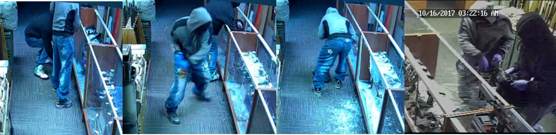 Image of the suspects actively robbing the store.