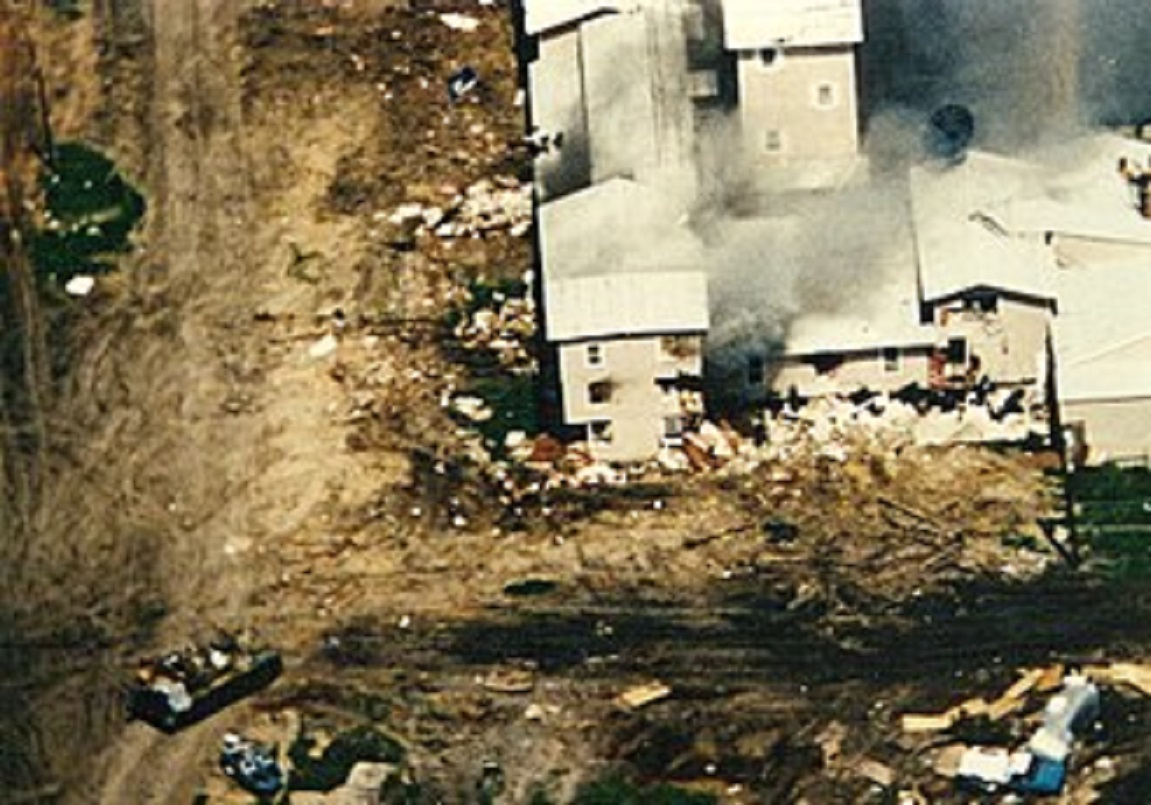 Aerial view of the Mount Carmel compound with smoke coming out of the windows.