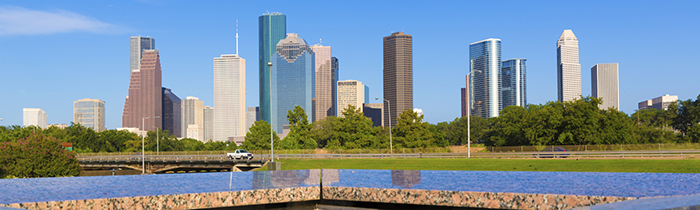 Image of the Houston skyline and the memorial pool.