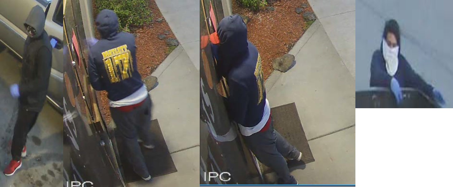 Image of suspects wanted for Granny's Gun Shop burglary with faces covered.