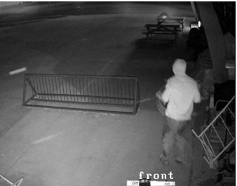 Still-frame photo of surveillance footage from the front of the business captured the night of the Bay Area Pawn burglary on July 30, 2018, in Ashland.