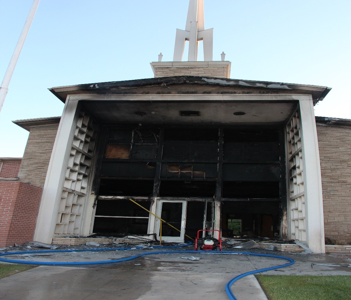 View of fire damage to the roof and outside main entryway of the church