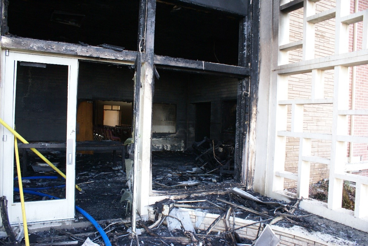 View of fire damage inside the main entryway of the church
