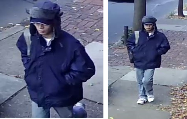 Suspect wearing a blue winter jacket, blue jeans and tennis shoes.