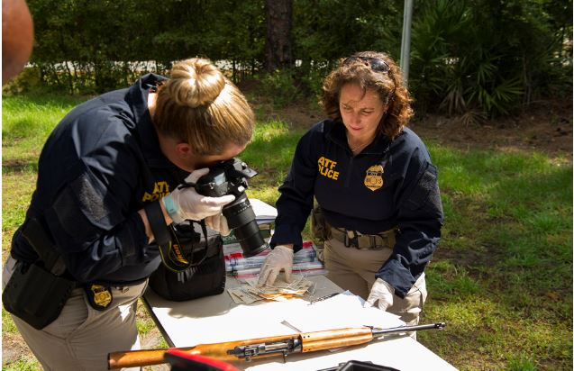 ATF special agents collect crime scene evidence