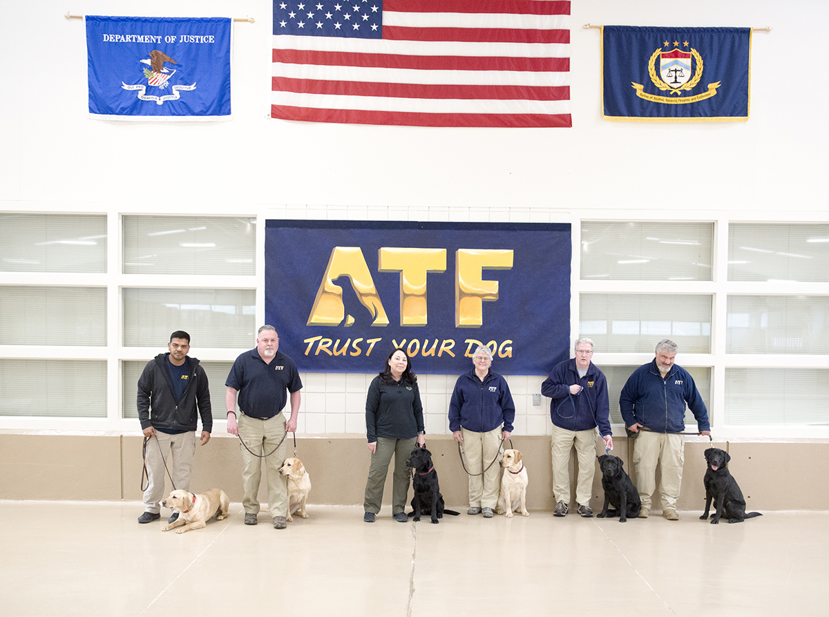 ATF National Canine Training Center Instructors Team and Special Agent Grace Reisling