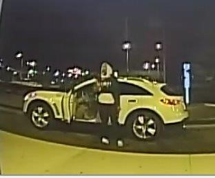 Person of interest in hoodie in front of yellow sports car.