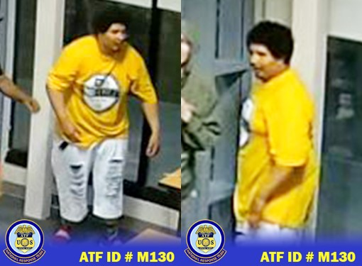 Male suspect wearing a yellow t-shirt and light blue ripped denim jeans