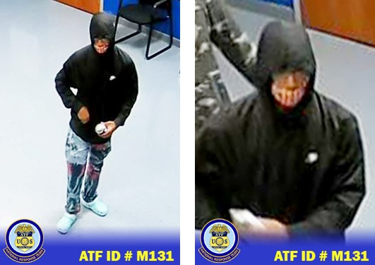 Male suspect wearing black hoodie, face covered, eye glasses, distressed denim jeans