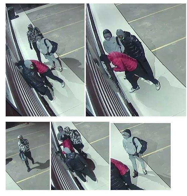 Still-frame surveilance footage of suspects at Palace City Pawn