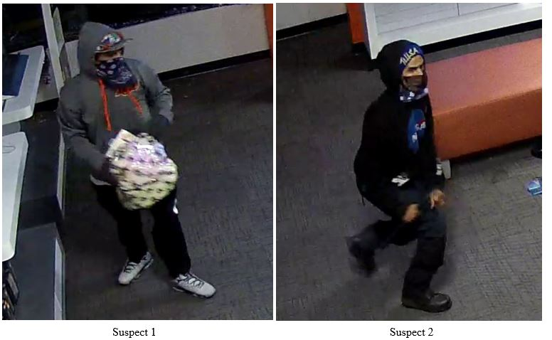 Two suspects captured on surveillance footage at Tulas shopping center the night of the fire.