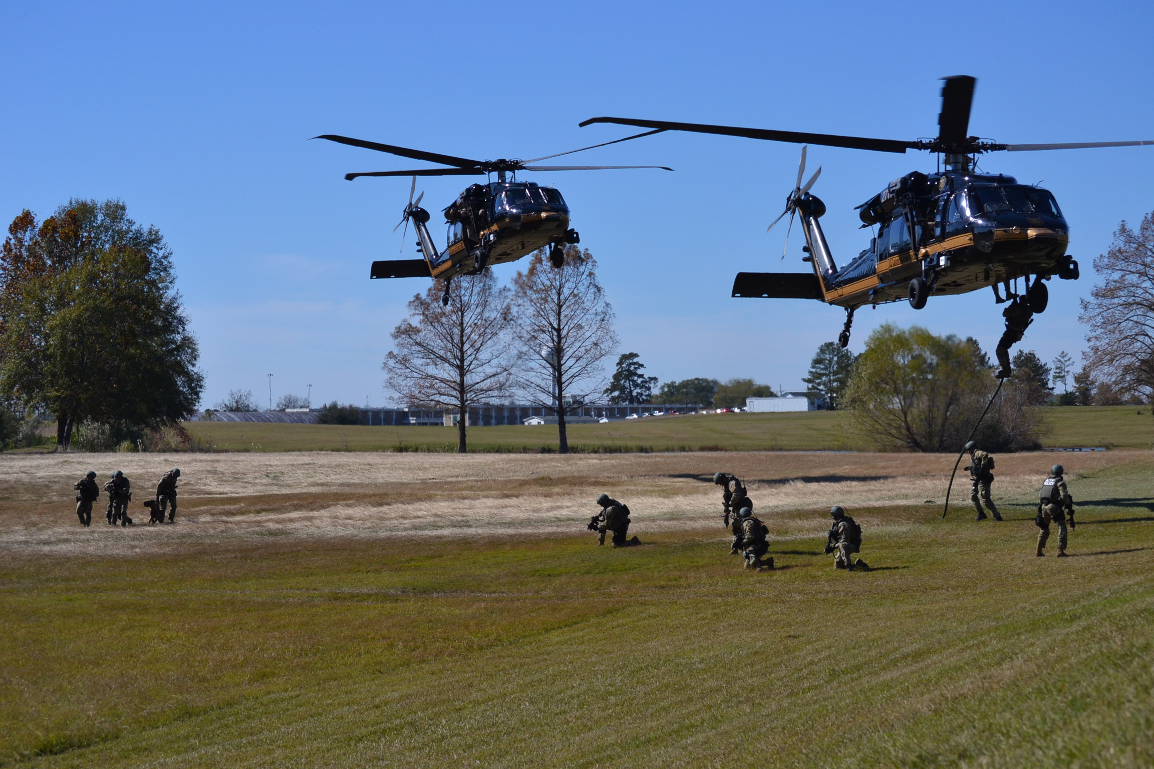 ATF Special Response Teams practice fast-roping from helicopters during training prior to an operation.