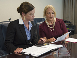 An industry operations investigator conducts an interview in the office