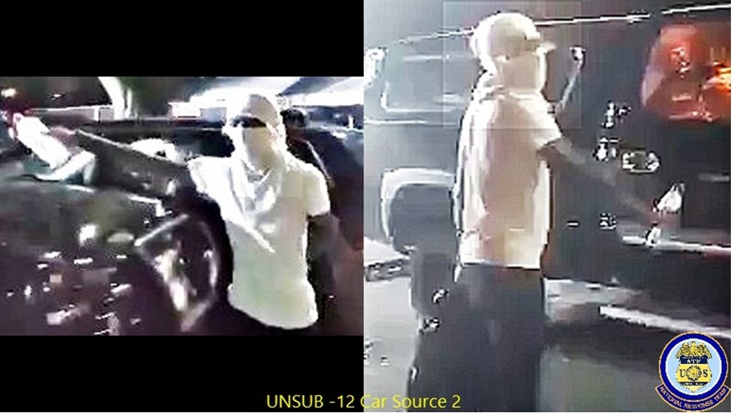 Arson suspect with face covered by white shirt