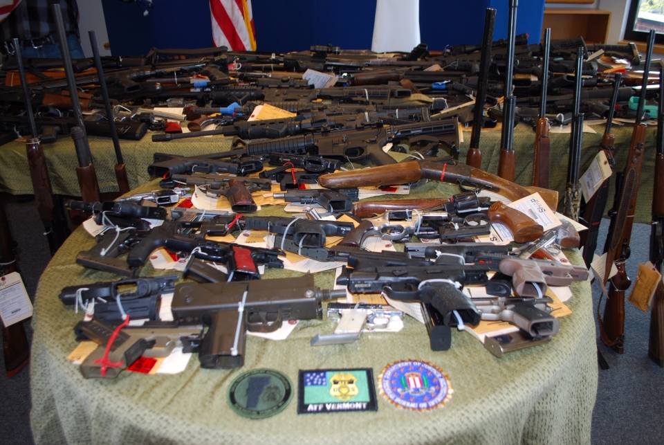 Close up of table displaying firearms
