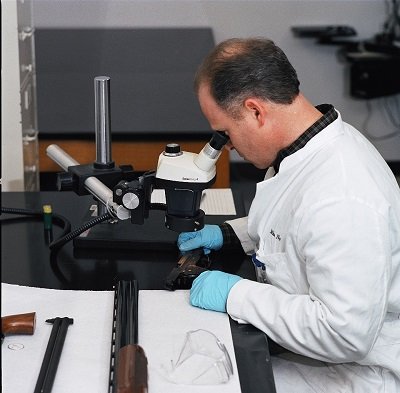 An examiner analyzes a firearm in the National Laboratory Center in Atlanta.