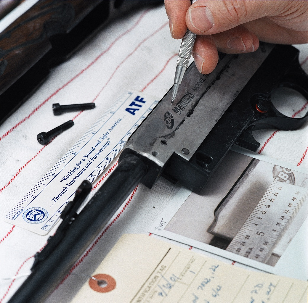 A forensics expert conducts a firearms trace