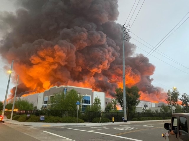 Amazon distribution center engulfed in flames.