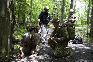 Agents respond to a simulated explosives incident during the annual Raven's Challenge