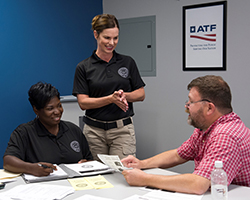 Industry Operations Investigator holds federal firearms licensee outreach class