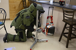 Raven's Challenge certified explosives specialist diffuses a device