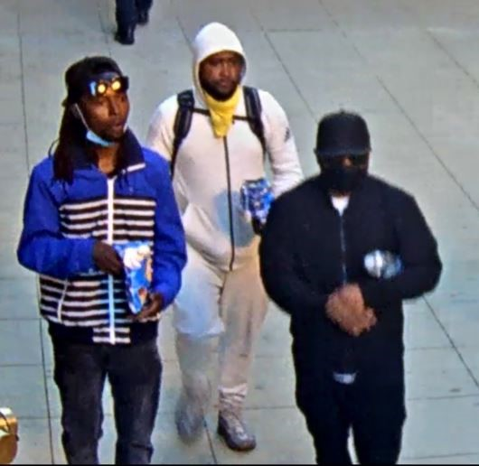 Suspect #2 wears a blue/black striped jacket, Suspect #3 a white hoodie and Suspect #4 a black outfit.