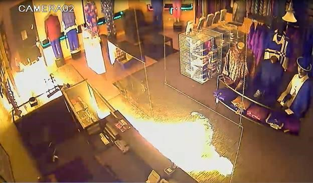 Flames inside the Top 2 Bottom Fashion store in Brooklyn Park, MN