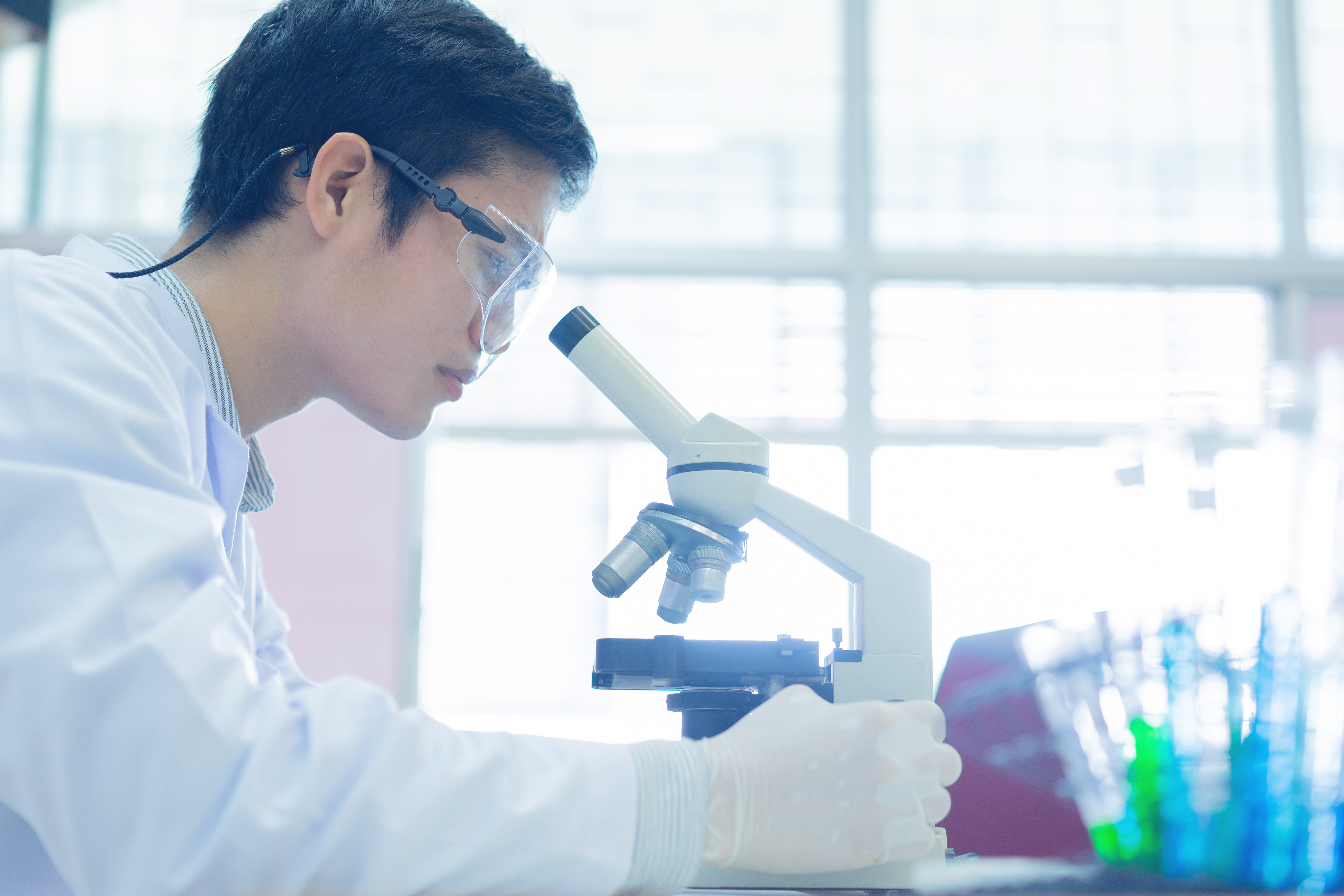A forensic biologist works in the lab