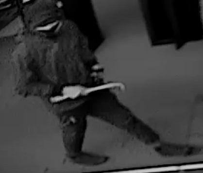 Suspect in Dunham's Sports burglary holding a crowbar