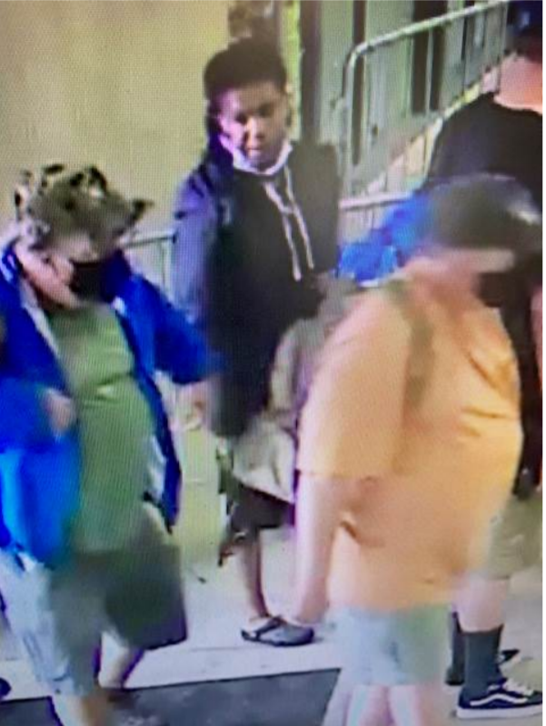 Suspect standing in line looking to the side