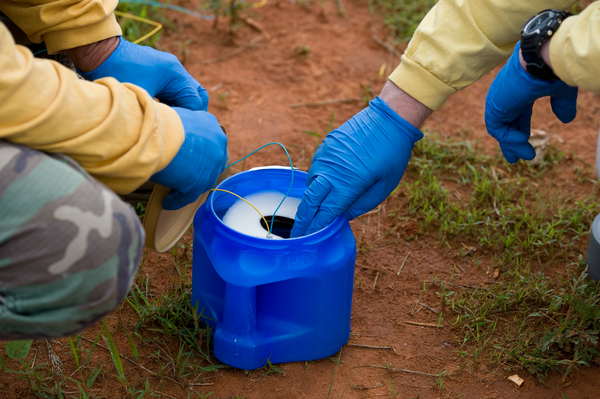 Experts examine an improvised explosive device during training