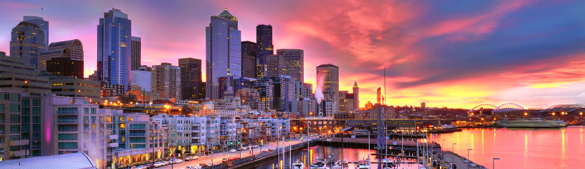 Image of the Seattle skyline and waterfront at sunrise