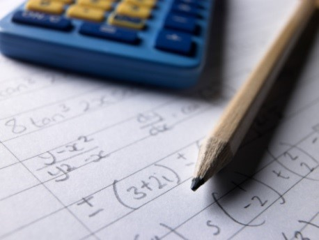 Picture of a pencil and calculator.