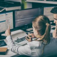 Man and woman looking at a computer screen